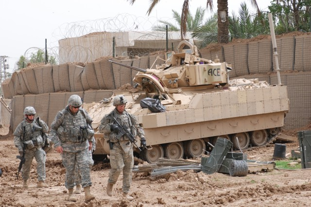 Lt. Gen. Ray Odierno inspects Zaganiyah Patrol Base, Iraq, April 29. With him are 1st Sgt. Royce Manis (right) and another Soldier.
