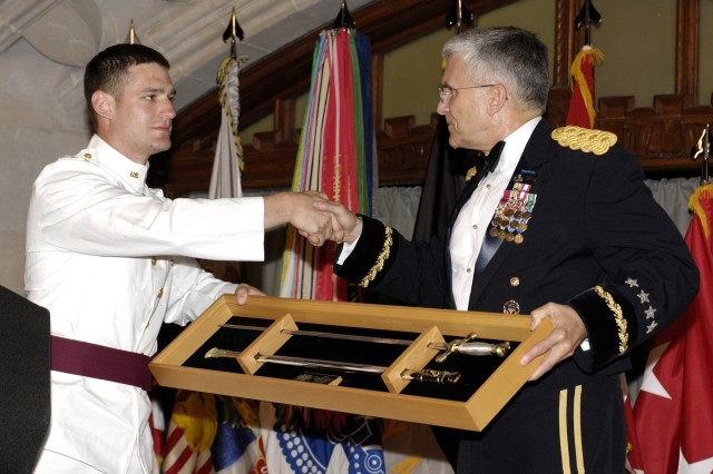 During the West Point events, Army Chief of Staff Gen. George W. Casey Jr. is presented a commemorative saber by class president Cadet John Enderle.