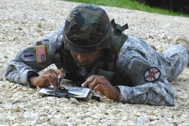 Sgt. Jake T. Brice, USAG Garrison Benelux,Belgium, identifies key points on a map during the land navigation event of the Installation Management Command-Europe Soldier and Noncommissioned Officer of the Year competition.