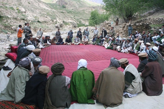 "An impromptu ""shura"" or town meeting with Soldiers and village elders takes place during Panjshir Province Governor Bahlol Bajig's visit to the Tul District of Afghanistan, May 28."