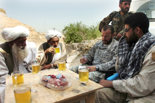 A Special Forces company commander meets with village elders and members of the 1st Kandak, 209th Afghan National Army Corps, April 10, to discuss military operations in the Sangin District area at an undisclosed forward operating base in Helmand Province.
