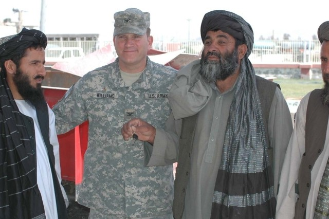 Col. R. Stephen Williams, the commander of the 207th Infantry Brigade, meets with local leaders in Kandahar Province, Afghanistan, May 15. The Soldiers are helping with improvements for area farmers.