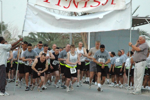 Runners start their own clocks as they begin their 13.1-mile half marathon, sponsored by Task Force Indy at Camp Victory, Iraq, May 5.