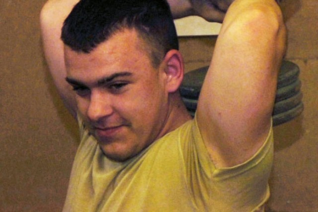 Pvt. Chad Sebour, from Company C, 1st Battalion, 505th Parachute Infantry Regiment, 82nd Airborne Division, works out in a gym at Joint-Security Station Arvanitis-Sigua in Bayji, Iraq, April 23.