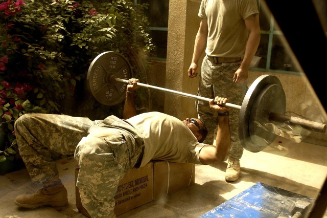 A Soldier spots Sgt. Javier Espitia as he does bench presses at Command Outpost Cahill, in Salman Pak, Iraq, April 24. The Soldiers are from 2nd Platoon, Company A, 1st Battalion, 15th Infantry Regiment, 3rd Brigade Combat Team, 3rd Infantry Division.