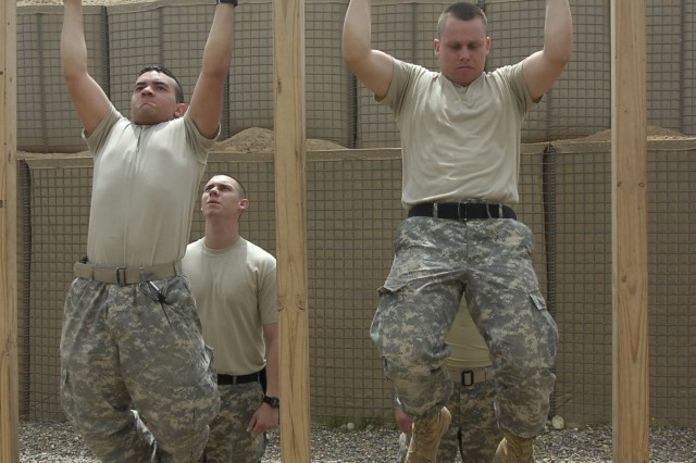 Paratroopers from 1st Battalion, 319th Airborne Field Artillery Regiment, 82nd Airborne Division, do pull-ups at an outdoor gym built by fellow Soldiers at Contingency Operations Base Speicher, Iraq.