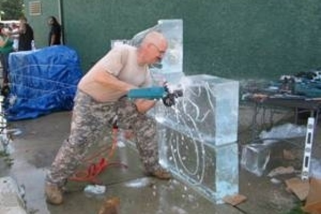 Chief Warrant Officer 4 Robert Sparks, Ft. Lee, Va., uses a chainsaw to carve a sphinx out of 1500-pounds of ice at the Berwyn, Ill. International Food Festival.