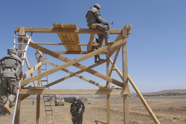 Soldiers from the 585th Engineer Company construct a guard tower at Forward Operating Base Logar, Afghanistan, May 18.