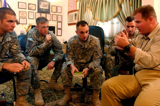 First Lt. Nicholas Ziemba (far left), Capt. Blake Keil (left), Capt. Dustin Walker (center), and Maj. Matt Zimmerman (right rear), all of the 2nd Battalion, 15th Field Artillery Regiment, 2nd Brigade Combat Team, 10th Mountain Division (Light Infantry), out of Fort Drum, N.Y., spoke with Dr. David Kilcullen (right front), counterinsurgency adviser to Gen. David Petraeus, commander of U.S. forces in Iraq, at the Mahmudiyah Iraqi Army Compound June 3.
