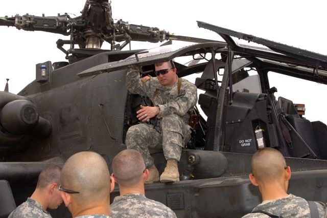 Capt. Jeorge King, an AH-64D Apache helicopter pilot and commander of Headquarters and Headquarters Company, 1st Air Cavalry Brigade, 1st Cavalry Division, explains to Soldiers how to extract a pilot from the cockpit of an Apache if he or she were injured.