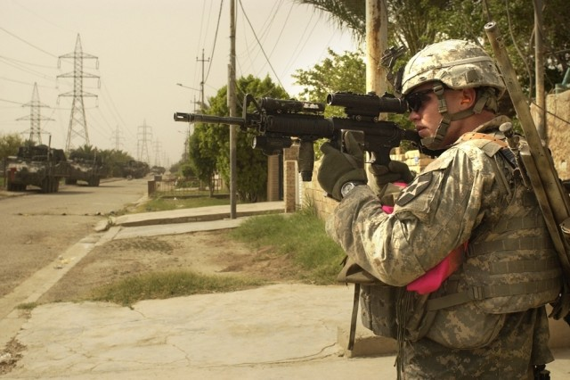 A Soldier searches for insurgents, which are suspected to be in the area.