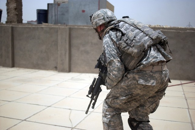 Insurgents start shooting and Sgt. Andrew Britt moves to a more favorable rooftop position.