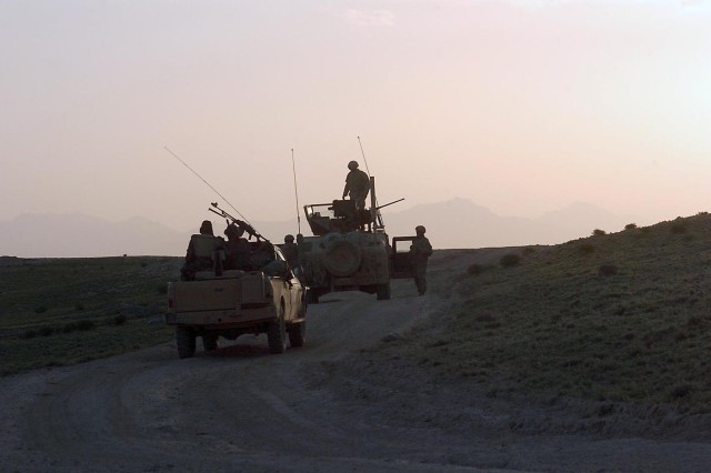 Paratroopers from 3rd Platoon, Troop B, 4th Squadron, 73rd Cavalry Regiment, 4th Brigade Combat Team, 82nd Airborne Division, prepare their vehicles for a night trip across the rugged terrain of Paktika Province, Afghanistan.