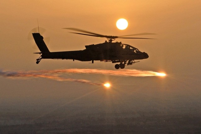 An AH-64D Apache helicopter fires flares as Soldiers from the 227th Aviation Regiment, 1st Air Cavalry Brigade, 1st Cavalry Division, based at Camp Taji, conduct a mission over Iraq, April 29.
