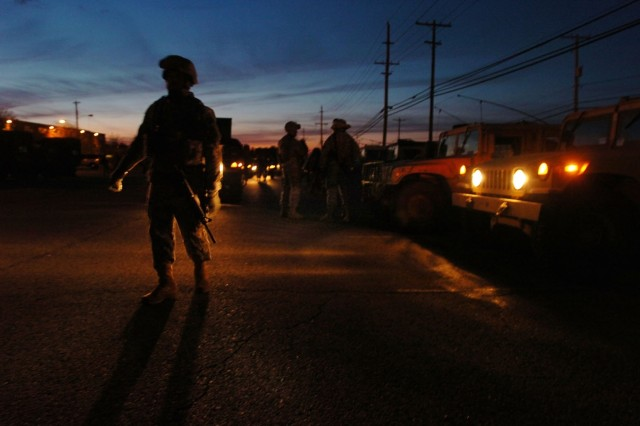 Soldiers from the 58th Brigade Combat Team direct traffic at the motor pool in Fort Dix, N.J., after returning from training, May 6. The brigade is preparing for a deployment to Iraq.