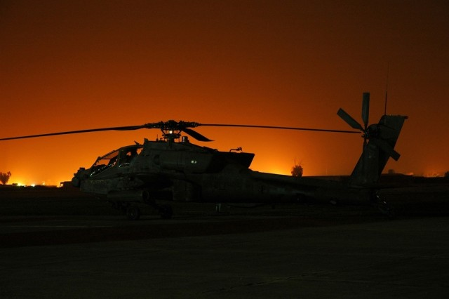 Soldiers in an AH-64D Apache helicopter at Camp Taji, Iraq, prepare for a mission, May 3. The Soldiers are from Company D, 615th Aviation Support Battalion, 1st Air Cavalry Brigade, 1st Cavalry Division.