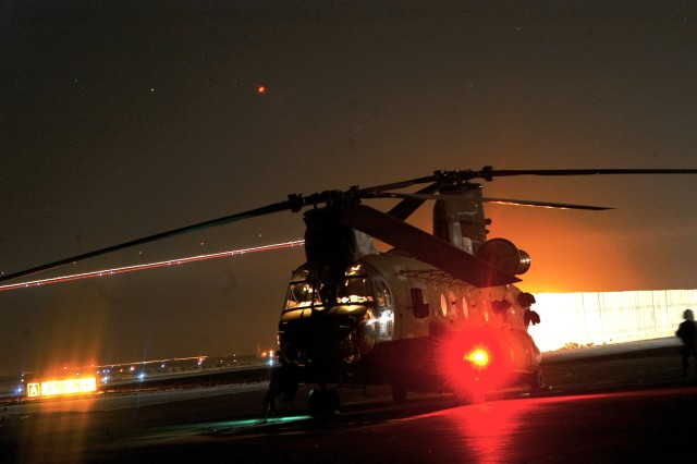 A Company B, 2nd Battalion, 135th Aviation Regiment, 36th Combat Aviation Brigade CH-47 Chinook prepares to conduct a nighttime mission at LSA Anaconda, Iraq.