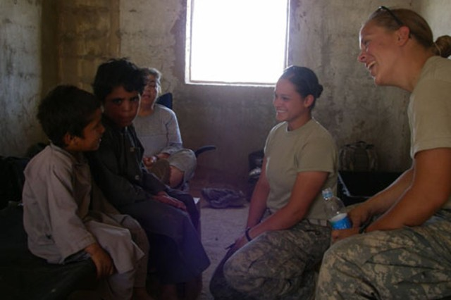 U.S. Army soldiers work with local children during a village medical outreach program in the Helmand province of Afghanistan, June 4, 2007. The soldiers are from 1st Battalion, 508th Parachute Infantry Regiment, 4th Brigade Combat Team, 82nd Airborne Division.
