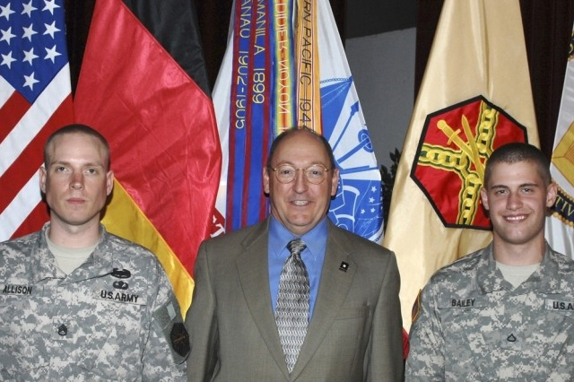 Russell Hall, director of IMCOM-Europe, poses with the command's NCO and Soldier of the Year winners, Staff Sgt. Todd Allison, left, and Pfc. Jarrod Bailey.