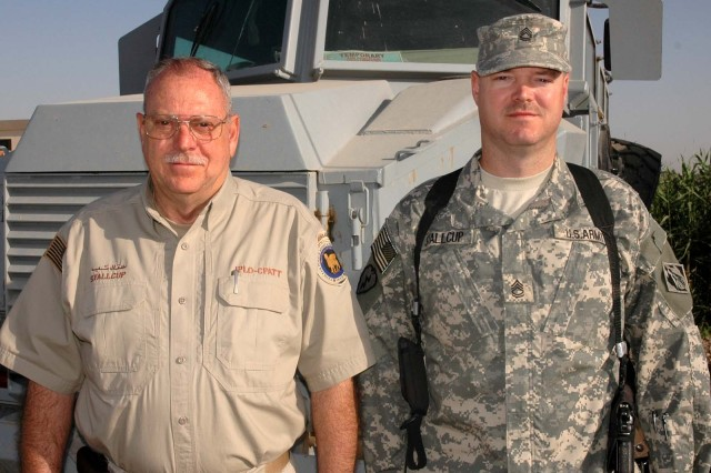 Howard Stallcup, a retired Army first sergeant, training Iraqi police. His son, Sgt. 1st Class Robert Stallcup, is with the Army Corps of Engineers, helping to rebuild the country's essential services.