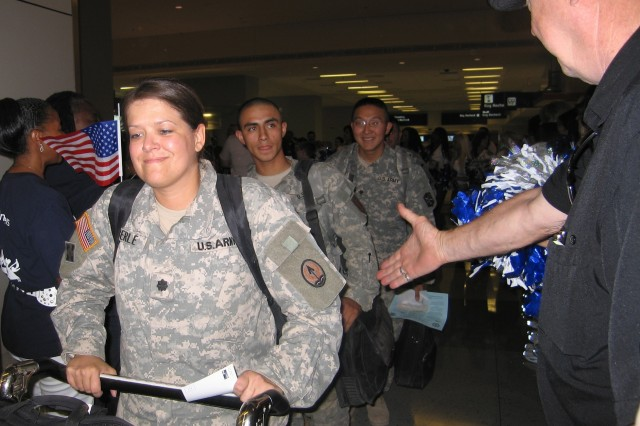 Soldiers arriving from Iraq and Afghanistan are greeted by more than 200 guests at the Dallas/Fort Worth International Airport. Guests and dignitaries were there to honor and celebrate the arrival of the 500,000th servicemember returning home for two weeks of leave since 2003.