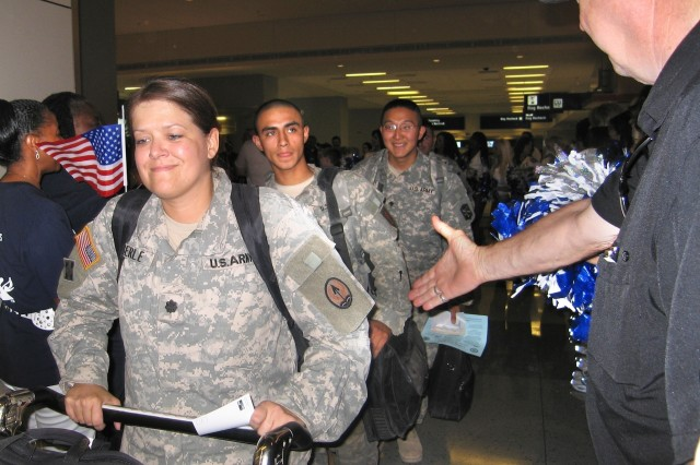 Soldiers are greeted by hundreds of well wishers in the terminal. Atlanta's Hartsfield International Airport hosted a similar welcome this month.