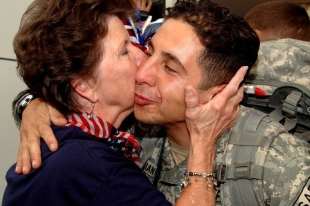 Linda Tinnerman greets a returning Soldier.