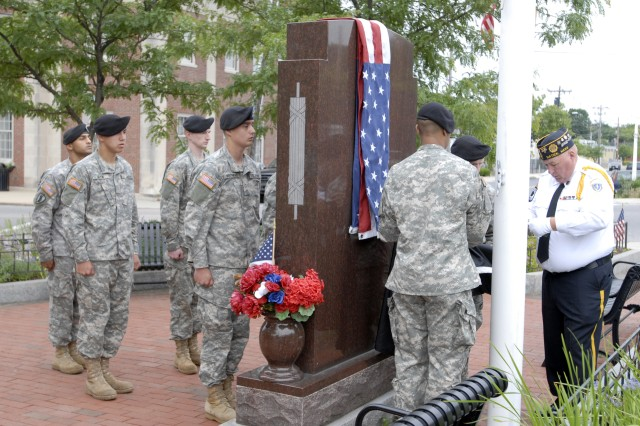 Soldiers from Natick Soldier Systems Center joined the Town of Natick Veterans Council at the local veterans' memorial park for an early morning flag raising ceremony to celebrate both Flag Day and the Army Birthday.