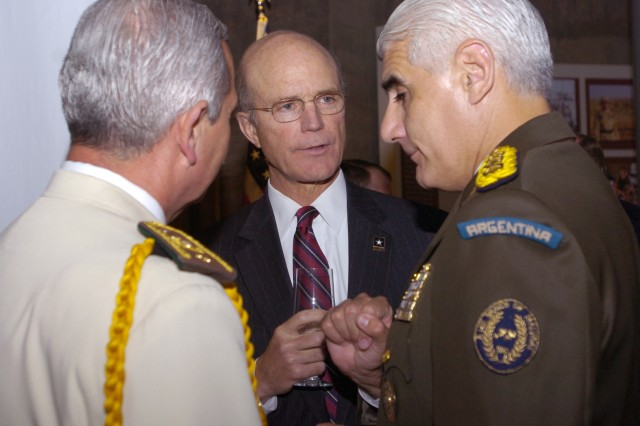 Acting Secretary of the Army Pete Geren talks with members of foreign militaries during the Twilight Tattoo Reception at the Women's Memorial in Washington, D.C., June 13.