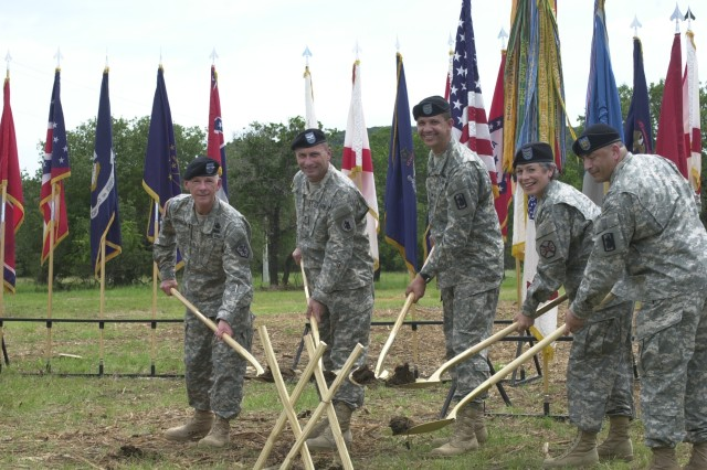 (From left) Maj. Gen. John DeFreitas, commander, U.S. Army Intelligence and Security Command; Col. Dan Meyer, U.S. Army South chief of staff; Col. Richard Saddler, former commander, 470th Military Intelligence Bridage; Col. Wendy Martinson, commander, U.S. Army Garrison Fort Sam Houston; and Staff Sgt. Martin Martinez, 470th MI Bde., break ground June 5 at Camp Bullis for the Department of Defense's first joint detention training facility.