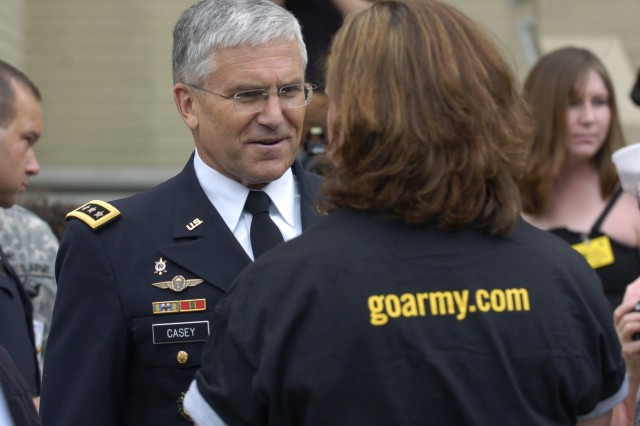 Chief of Staff of the Army Gen. George Casey talks with a new Soldier he enlisted during the Army Birthday Cake Cutting Ceremony at the Pentagon, June 14.