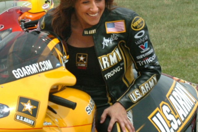 Army Suzuki racer Angelle Sampey, the National Hot Rod Association's winningest female with 40 career victories, jokes with Peggy Llewellyn (not pictured) after her victory over Chris Rivas in the second round of eliminations.