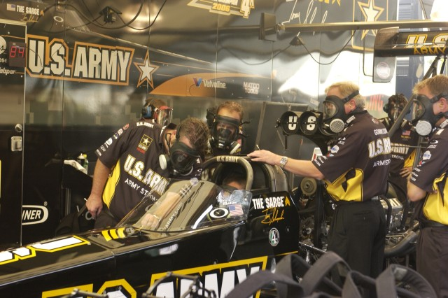 "The Army racing team tests the top fuel dragster engine at the Torco Racing Fuels Route 66 NHRA Nationals in Chicago. ""The Sarge"" has won four championships and is defending his 2006 title."