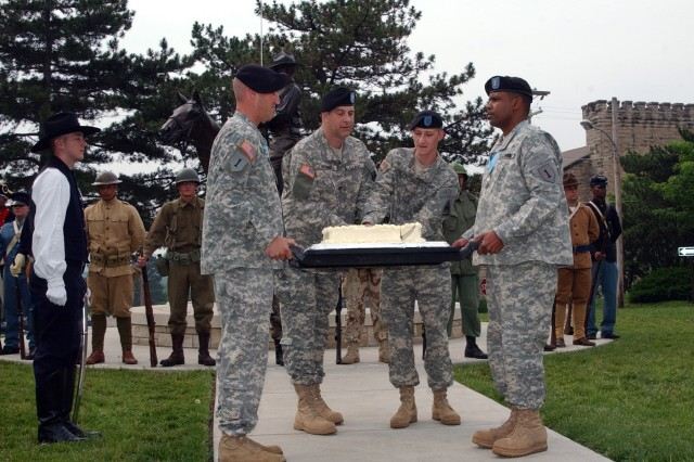 Col. Kevin O'Connell, 1st Sustainment Brigade commander, and Pvt. Lonnie Worley, representing the youngest Fort Riley Soldier, cut the Army's birthday cake at a ceremony June 14 at Fort Riley's Cavalry Museum.