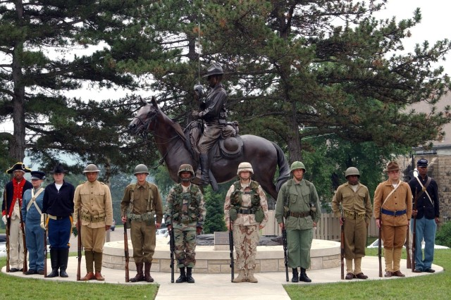 Fort Riley Soldiers represent various periods in the Army's history during a ceremony commemorating the Army's 232nd birthday June 14 at Fort Riley, Kan.