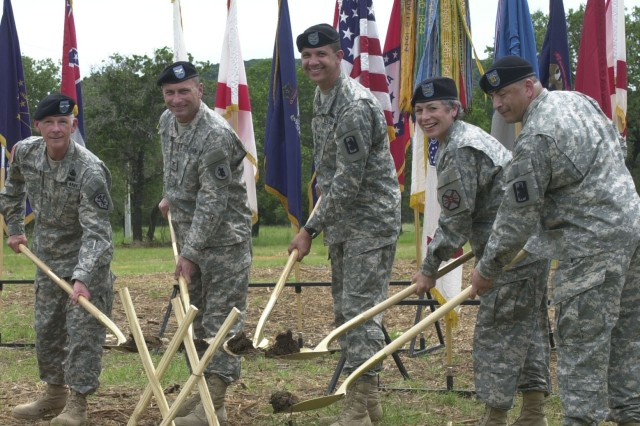 Maj. Gen. John DeFreitas, commander of U.S. Army Intelligence and Security Command; Col. Dan Meyer, U.S. Army South chief of staff; Col. Richard Saddler, former commander of 470th Military Intelligence Brigade; Col. Wendy Martinson, commander of U.S. Army Garrison Fort Sam Houston; and Staff Sgt. Martin Martinez of the 470th Military Intelligence Brigade, break ground June 5 at Camp Bullis, Texas, for the Defense Department's first joint detention training facility.