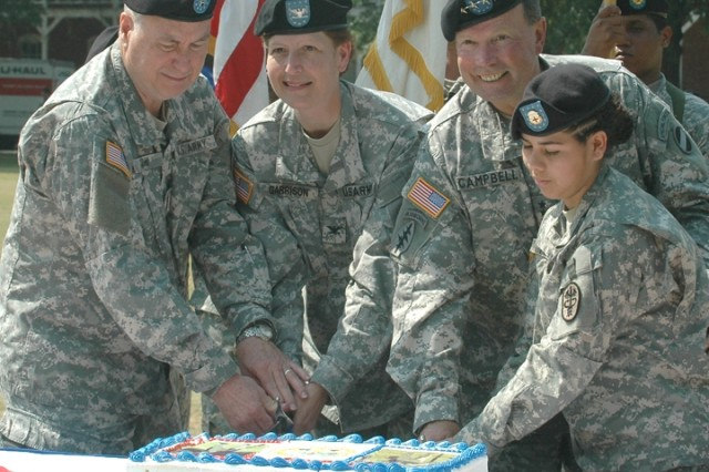 Gen. Charles Campbell, commanding general of U.S. Army Forces Command, and Col. Marguerite Garrison, garrison commander of Fort McPherson and Fort Gillem, cut the Army Birthday cake with Pvt. Melba Herrera, right, the youngest Soldier on the installation, and Chief Warrant Officer Four Hubert Denson, left, the oldest Soldier on the installation, during a ceremony on Fort McPherson's Hedekin Field June 14.