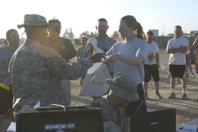 Cpt. Megan Leitch, from Fairfax, Va., director of operations for the 557th Expeditionary Red Horse Squadron, placed first in the female category during the five kilometer Army Birthday Fun Run June 14, at Forward Operating Base Hammer, Iraq.