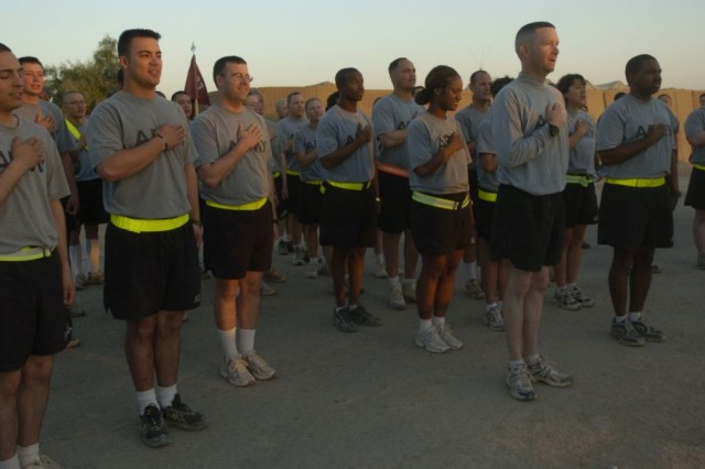 "Soldiers of the 3rd Heavy Brigade Combat Team, 3rd Infantry Division, recite ""The Pledge of Allegiance"" before the five kilometer Army Birthday Fun Run June 14, at Forward Operating Base Hammer, Iraq."