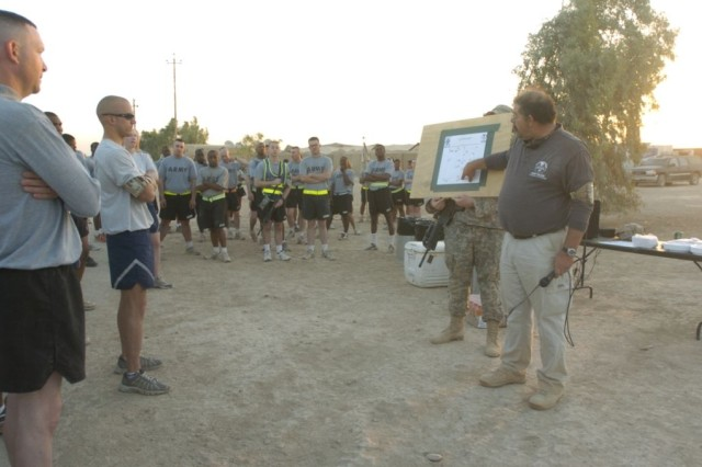 etired 1st Sgt. John Ellis, Sr., from Savannah, Ga., the brigade athletics director, explains the run route before the five kilometer Army Birthday Fun Run June 14, at Forward Operating Base Hammer, Iraq.