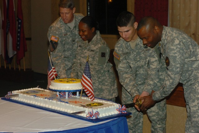 Left to right: Col. Todd Buchs, Fort Stewart and Hunter Army Airfield garrison commander is assisted by Lt. Charlene Smalls, 3rd BSB, 1BCT, in cutting the Army Birthday cake as Pvt. Refugio Figueroa, 3rd BSB, 1st BCT helps Stewart-Hunter garrison Command Sgt. Maj. Charles Durr.  Smalls and Figueroa were the junior most Soldiers present at the Army Birthday celebration June 14 at Club Stewart.