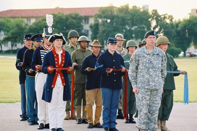 Army Birthday Soldiers in period uniform - Command Sgt. Maj. Timothy Burke with Soldiers dressed in period stand ready to participate in the Army Streamer presentation during Fort Sam Houston's Army Birthday celebration June 14 at MacArthur Parade