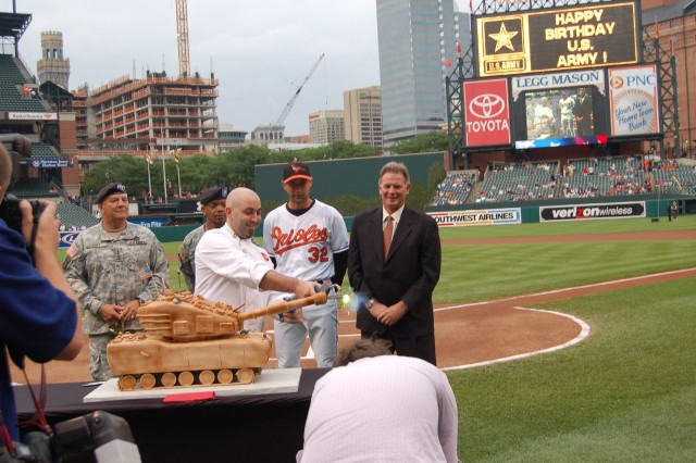 "Duff Goldman, host of the Food Network program ""Aces of Cakes,"" prepares to ignite his latest creation as part of pre-game events in honor of the U.S. Army's 232nd Birthday June