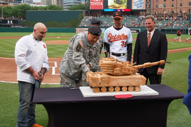 "Duff Goldman, star of the Food Network's ""Ace of Cakes,"" LTC Burl Randolph, Commanding Officer, Baltimore Recruiting Battalion, Baltimore Orioles pitcher Jamie Walker and Orioles General Manager Mike Flanagan, look on as GEN Richard Cody, U.S. Army Vice Chief of Staff, cuts an M1A1 Abrams cake to commemorate the 232nd Birthday of the U.S. Army June 14 at Camden Yards in Baltimore."