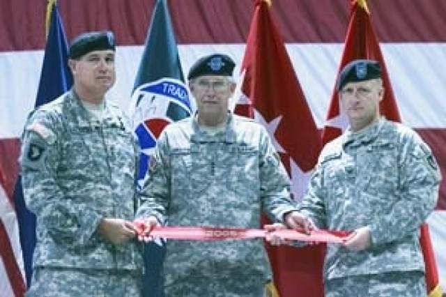 From left to right, Maj. Gen. James Pillsbury, commanding general of U.S. Army Aviation and Missile Command, Gen. Benjamin Griffin, U.S. Army Materiel Command commanding general and Col. Robert Swenson, Letterkenny Army Depot commander, holding the unit streamer prior to placement on the installation flag.