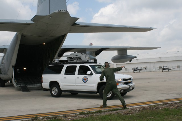 A U.S. Army North Region VI Emergency Response Vehicle is off-loaded from a Marine Corps C-130 aircraft in San Antonio, Texas for a state and federal emergency-preparedness exercise.