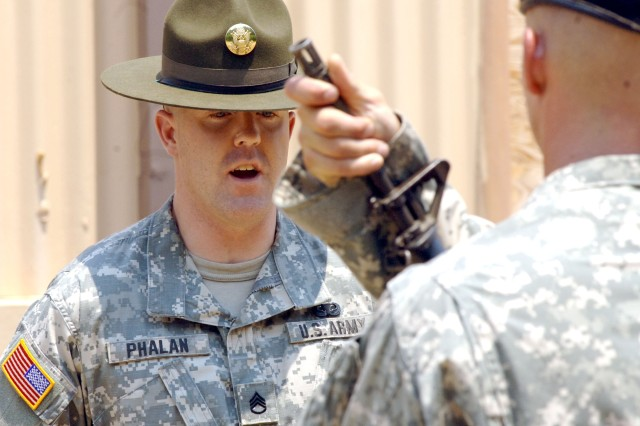 Staff Sgt. Christopher M. Phalan demonstrates his ability to teach the manual of arms.
