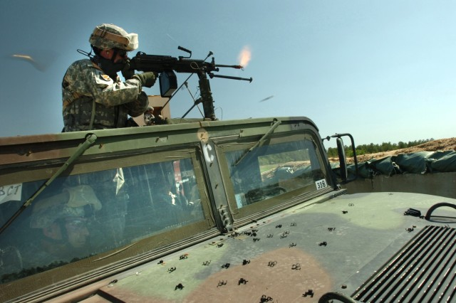 Sgt. 1st Class John Lavery fires his M249 Squad Automatic Weapon.