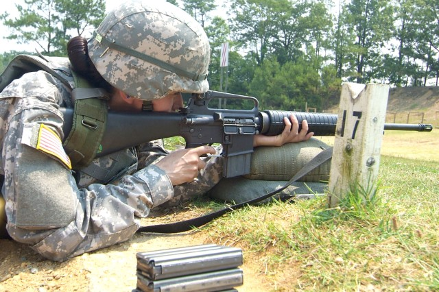 Staff Sgt. Velma Z. Britton zeros her rifle prior to qualification. That means adjusting the rifle sights so she can hit bull's-eyes.