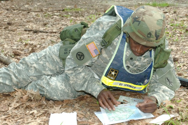 Sgt. 1st Class Henderson S. Springer plots a course during the land navigation portion of the competition.